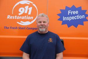911-restoration-water-damage-mold-remediation-fire-damage-person-van-man